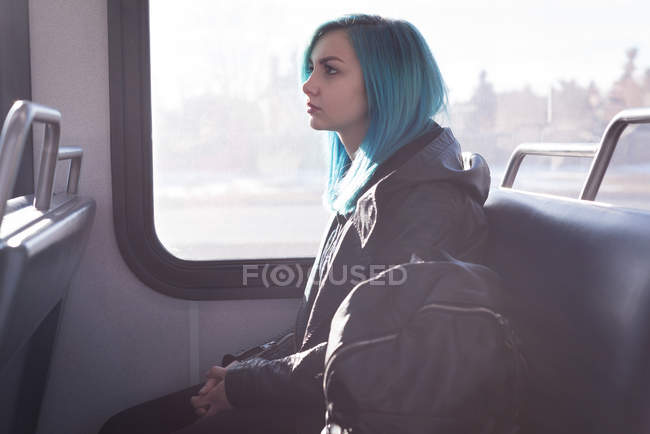 Thoughtful stylish woman travelling in train — Stock Photo