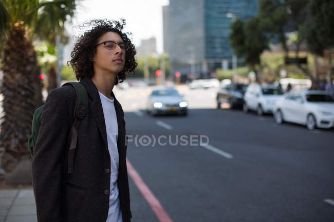 Young man waiting at the city street — Stock Photo