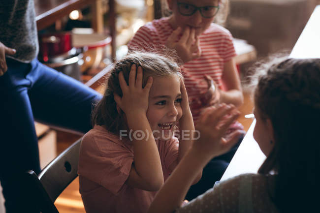 Sisters having fun in kitchen at home — Stock Photo