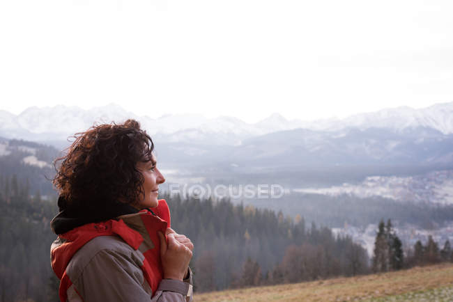 Thoughtful woman in warm clothes — Stock Photo
