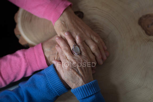 Close-up of senior woman consoling her senior friend at home — Stock Photo