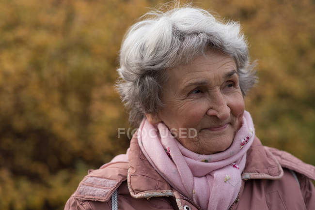Active senior woman in warm clothing outdoors — Stock Photo