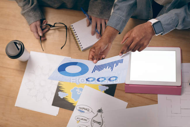 Executives discussing over graph chart in office — Stock Photo