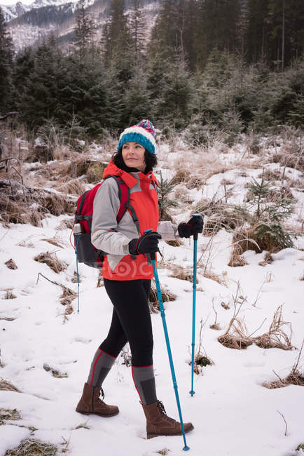 Thoughtful woman hiking in snowy region — Stock Photo