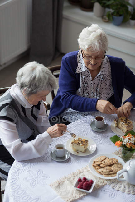 Senior friends having breakfast together at home — Stock Photo