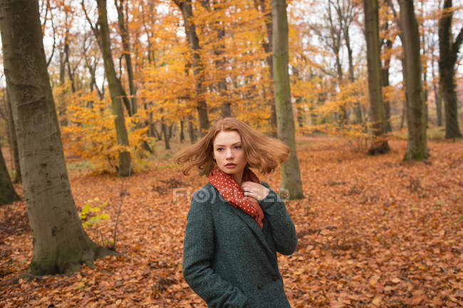 Woman standing with hand in pocket at park during autumn — Stock Photo