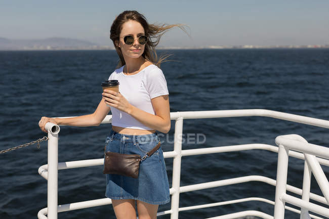 Beautiful woman having coffee on cruise ship — Stock Photo