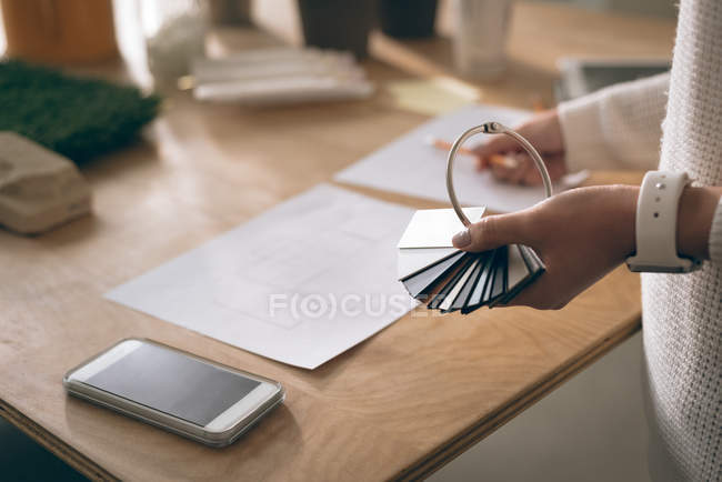 Close-up of executive holding sample of slabs in office — Stock Photo