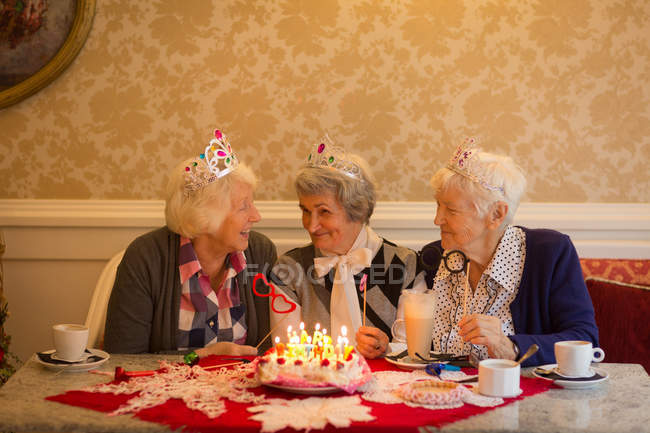 Senior friends having fun together at home — Stock Photo