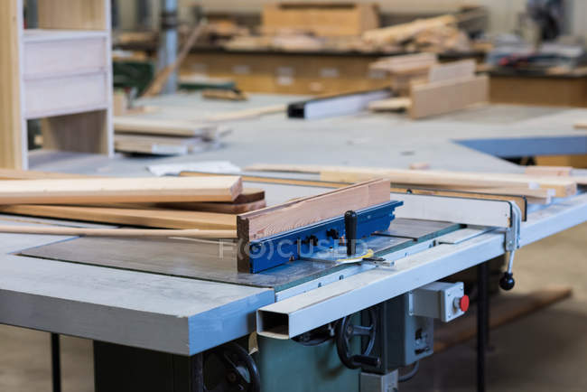 Wooden pieces and tools on worktop at workshop — Stock Photo