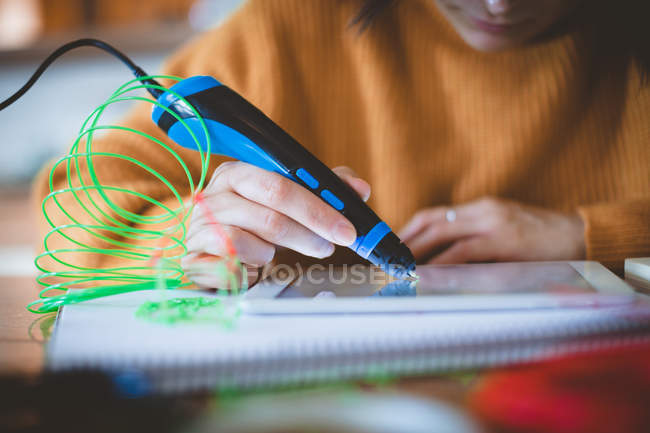 Woman using electric pen on digital tablet — Stock Photo