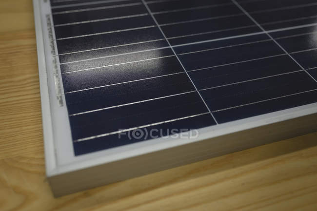 Close-up of solar panel on wooden table in office — Stock Photo