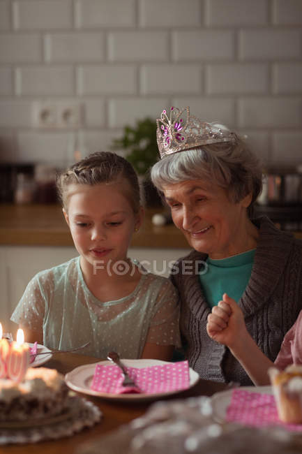 Grandmother celebrating her birthday with granddaughters at home — Stock Photo