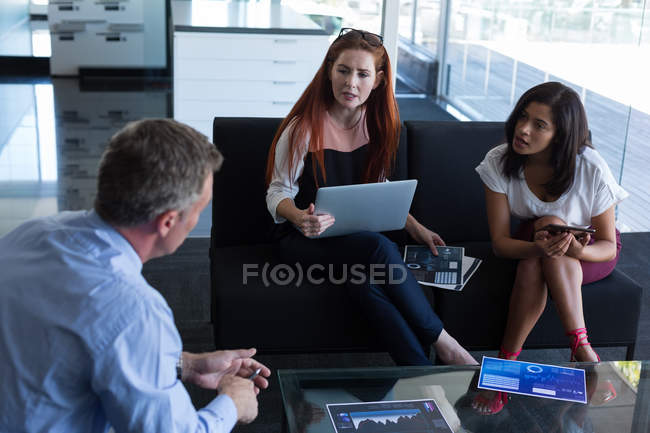 Business colleagues interacting with each other in meeting at office — Stock Photo
