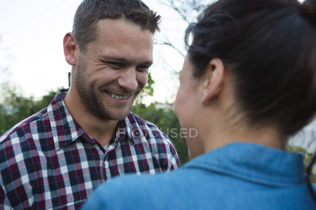 Romantic couple looking at each other in the garden — Stock Photo