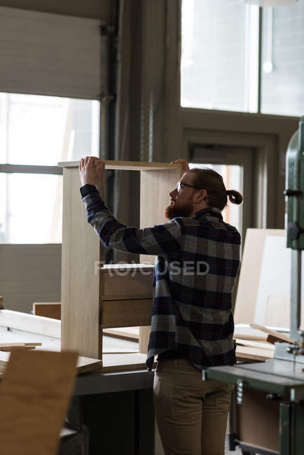 Attentive male carpenter working at workshop — Stock Photo