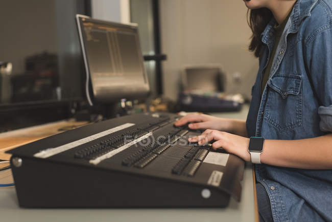 Mid section of female sound recordist working in theater — Stock Photo