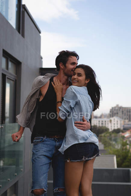 Couple embracing each other in the balcony at home — Stock Photo