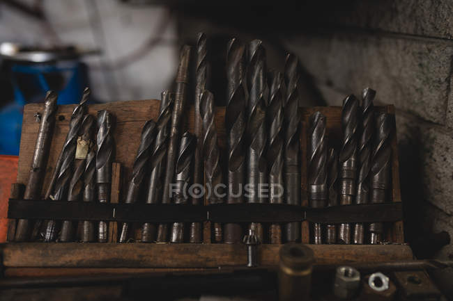 Close-up of drill bits arranged in workshop — Stock Photo