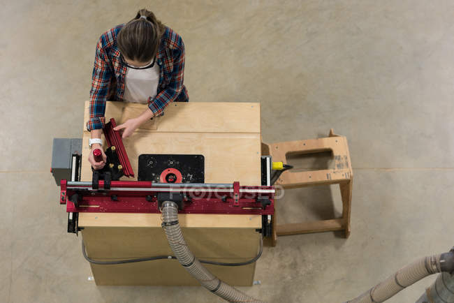 Overhead view of female carpenter working in workshop — Stock Photo