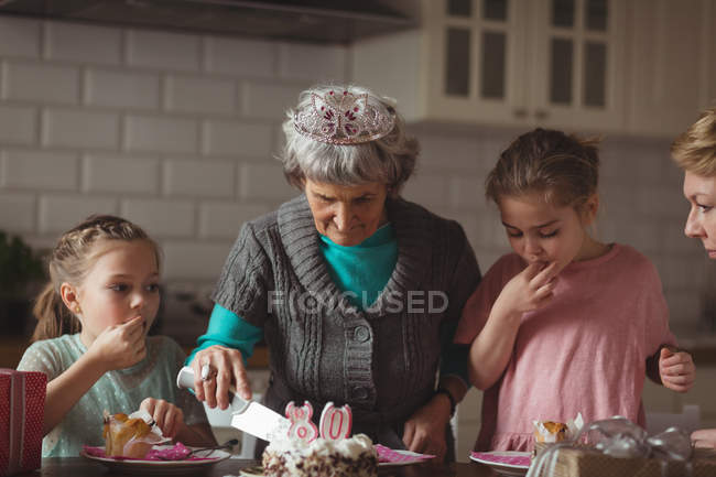 Grandmother celebrating her birthday with her family at home — Stock Photo