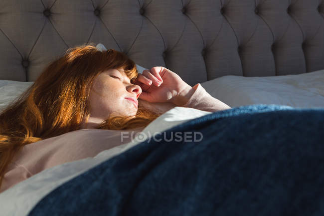 Woman sleeping in bedroom at home — Stock Photo