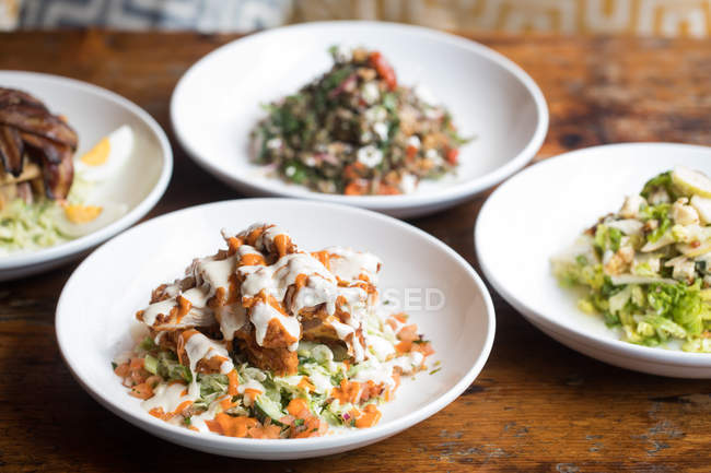 Close-up of healthy meals served in plates on table — Stock Photo