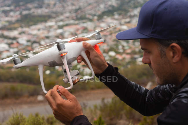 Close-up of man holding a flying drone — Stock Photo