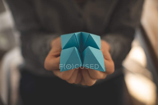 Close-up of women showing origami at home — Stock Photo