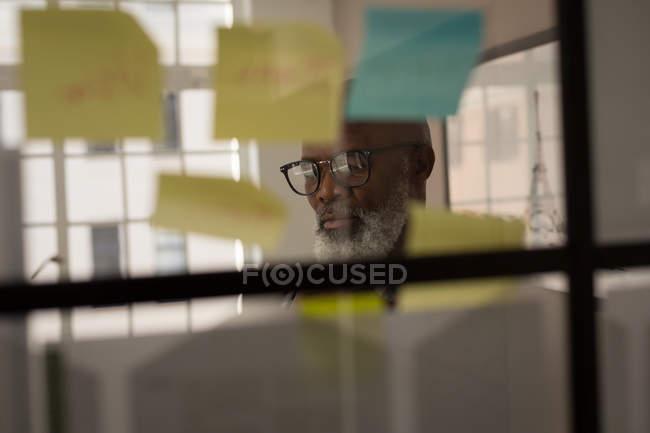 Attentive senior graphic designer working in office — Stock Photo