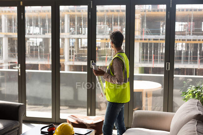 Female Architect Holding Blueprint In The Office One Person Real