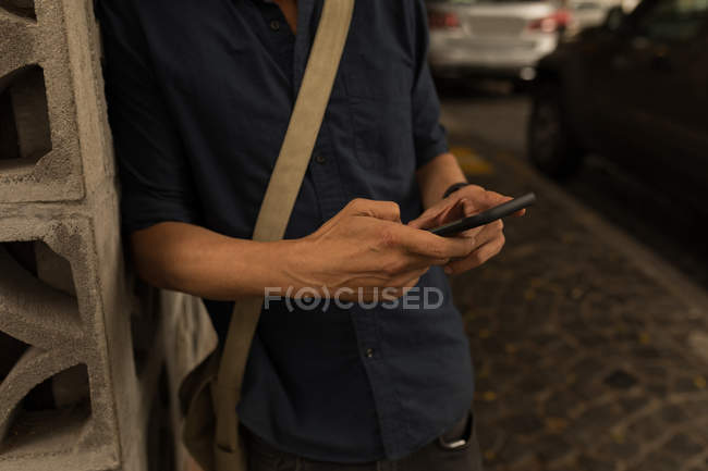 Mid section of businessman using mobile phone — Stock Photo