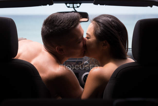 Romantic couple kissing each other in the car — Stock Photo
