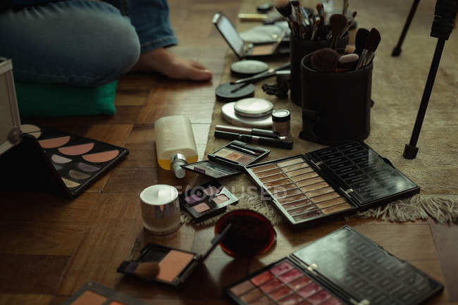 Low section of female video blogger with make up accessories at home — Stock Photo