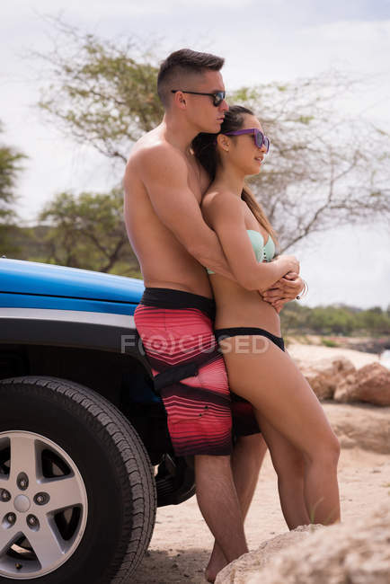 Romantic couple embracing each other near beach — Stock Photo