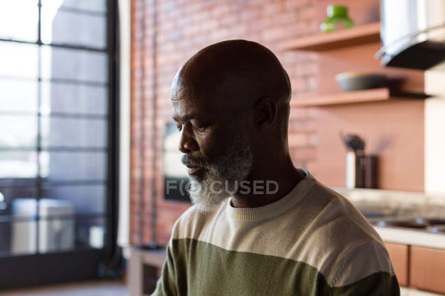 Thoughtful senior man relaxing at home — Stock Photo