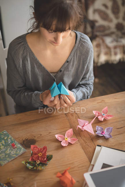 Beautiful woman preparing a paper craft at home — Stock Photo