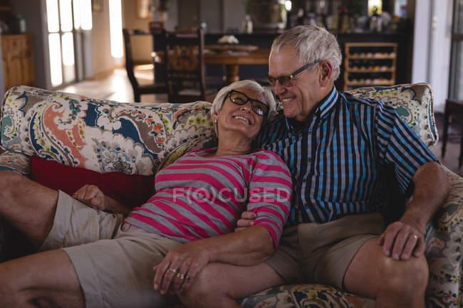 Romantic senior couple having fun in living room at home — Stock Photo