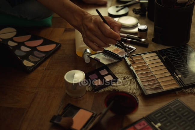 Close-up of female video blogger with make up accessories at home — Stock Photo