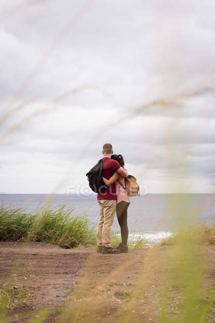 Romantic couple embracing each other in countryside — Stock Photo