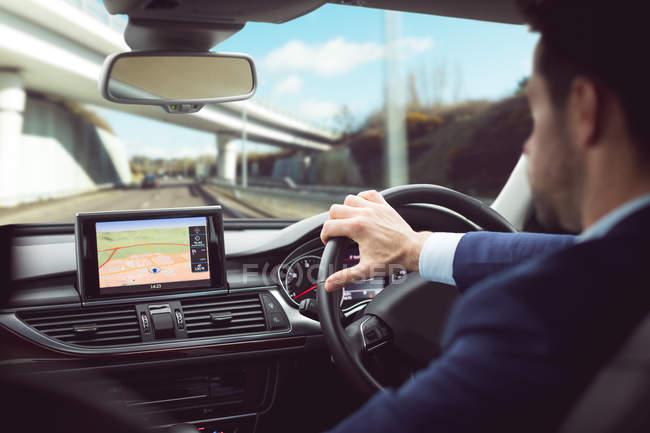 Businessman driving a modern car — Stock Photo