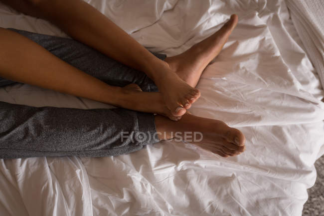 Couple sleeping in bedroom at home — Stock Photo