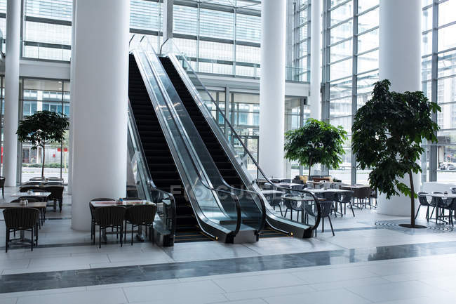 Escalator and cafeteria area inside the office — Stock Photo