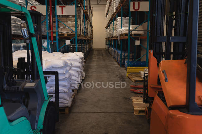 Various materials in rack at warehouse — Stock Photo