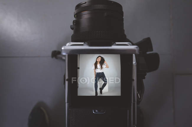 Close-up of models picture on digital camera in photo studio — Stock Photo