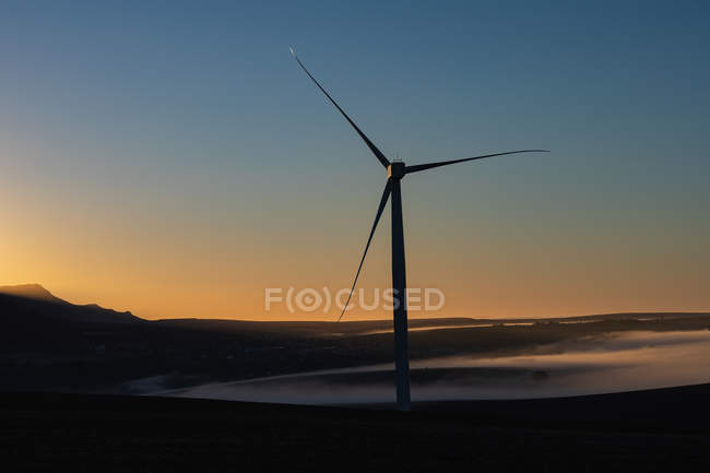 Wind mill at a wind farm during dusk — Stock Photo
