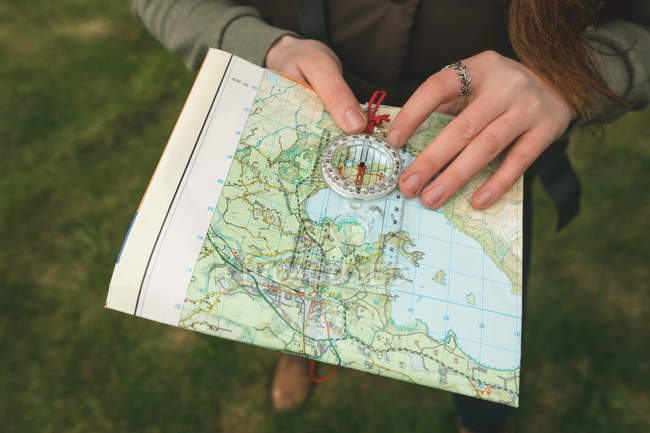 Close-up of female hiker reading a map — Stock Photo