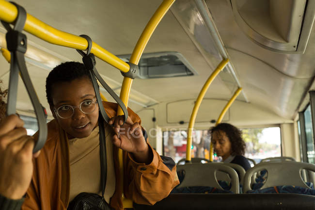 Thoughtful woman traveling in the bus — Stock Photo