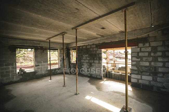 Interior of a building under construction on a sunny day — Stock Photo