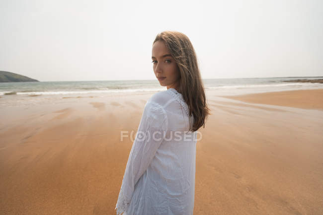 Beautiful woman on the beach on a sunny day — Stock Photo